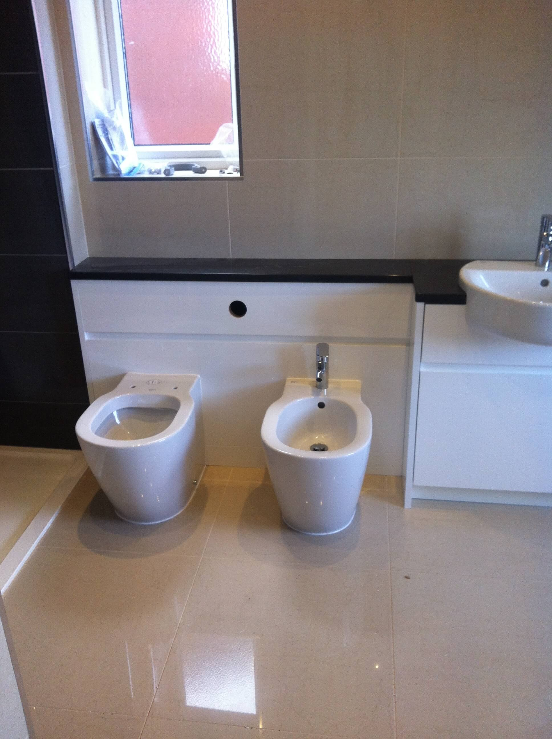 The toilet and Bidet have been installed