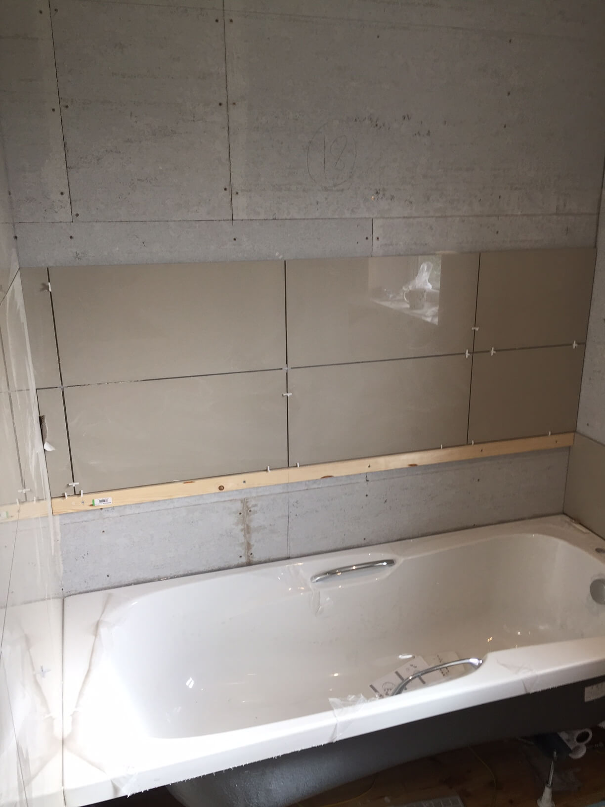 Starting To Tile Over the Bath