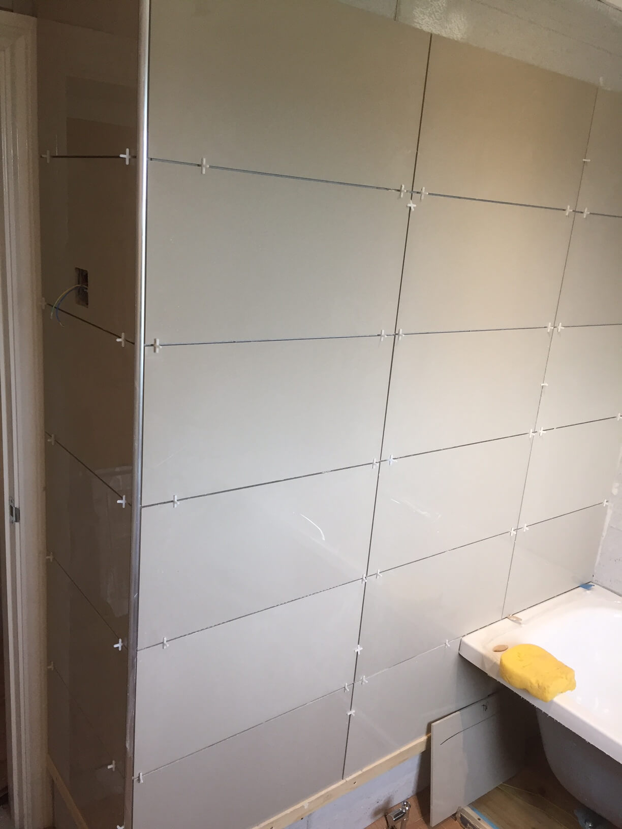 Tiles starting to go up
