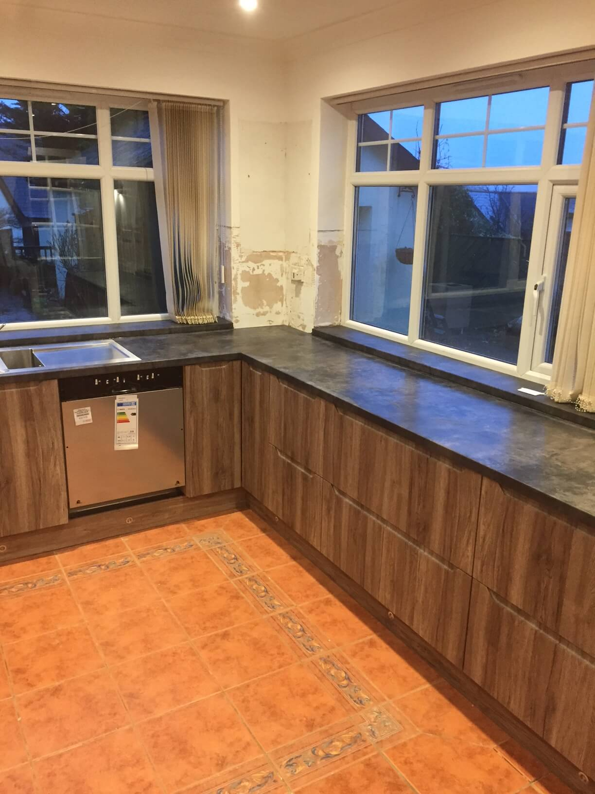 Worktop fitted as window cills