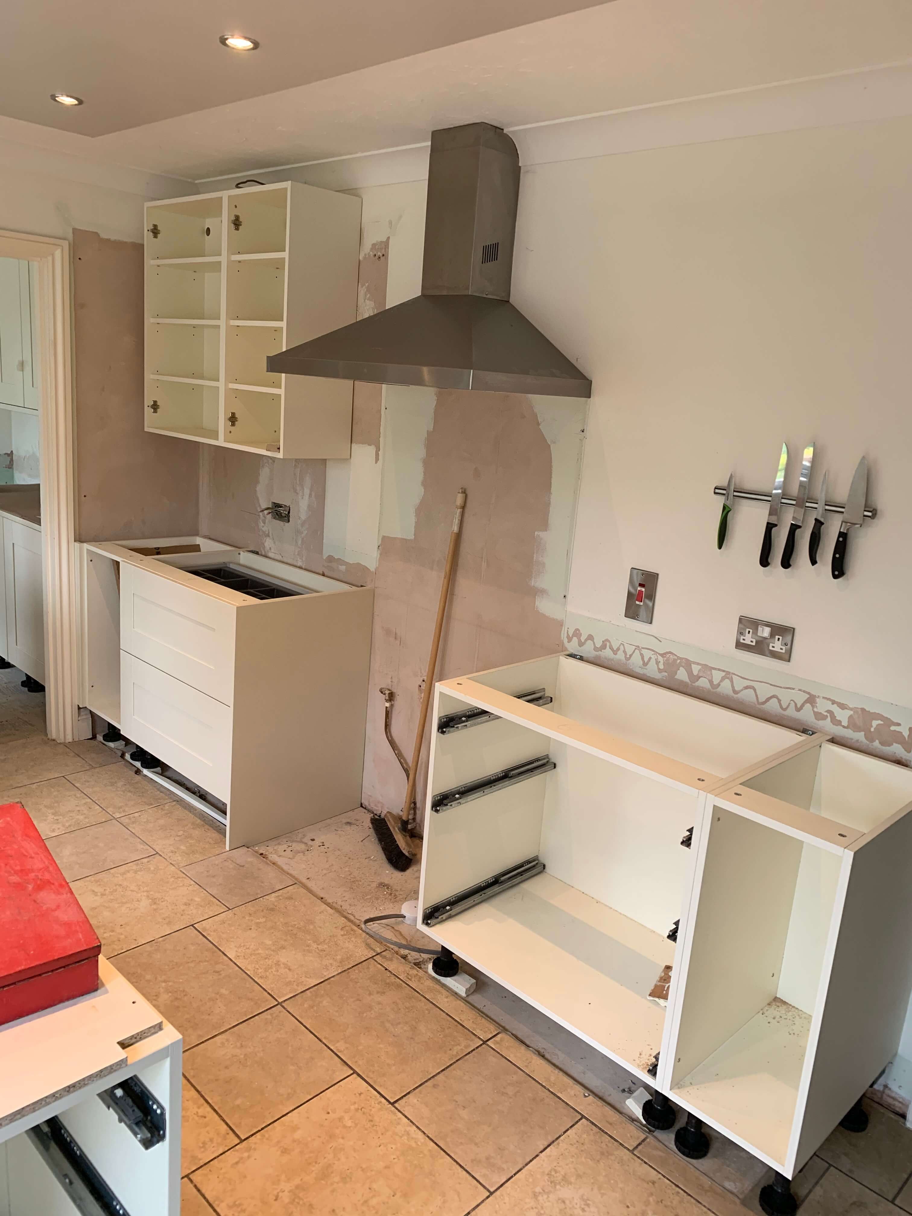 Kitchen wall units and extractor are fitted