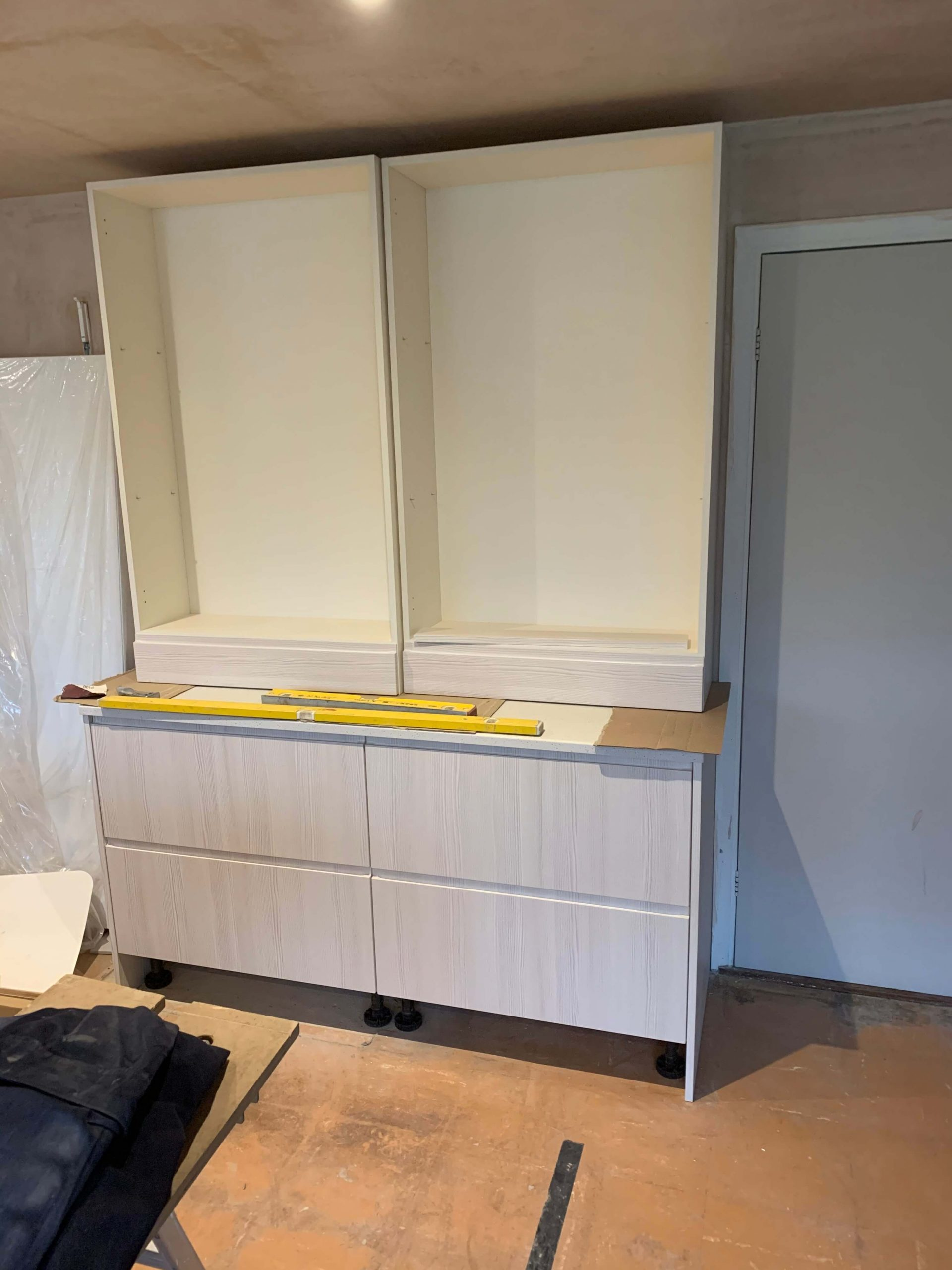 Dresser cupboards being fitted